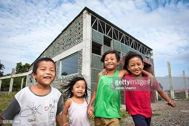 Children in front of Asia's first bottle school.