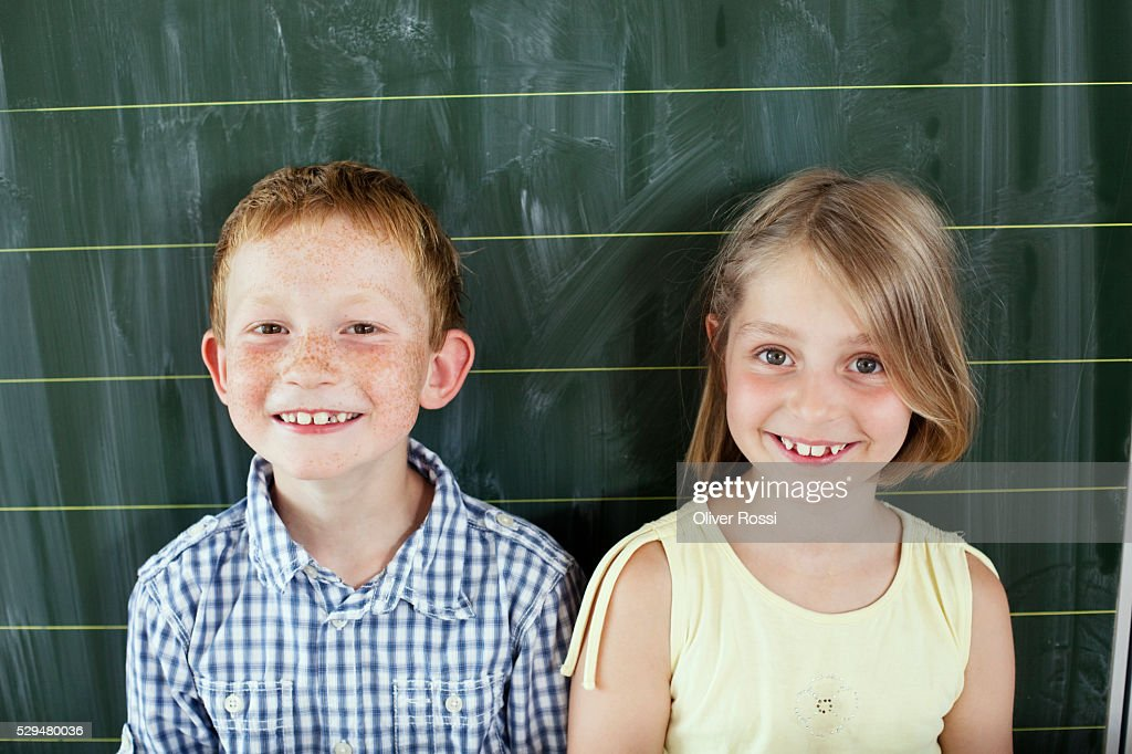 Children in front of blackboard : Stock Photo