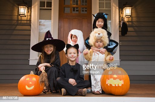 Children in Halloween costumes with pumpkins : Stock Photo
