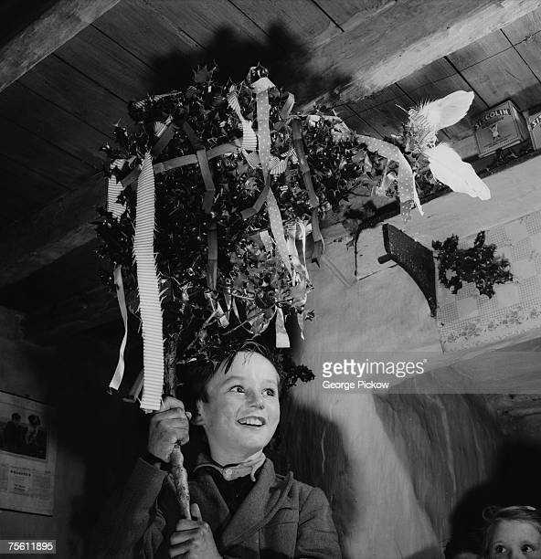 Children in Ireland celebrate St Stephen's Day or 'Wren's Day' on 26th December by processing from house to house with a branch of holly circa 1955
