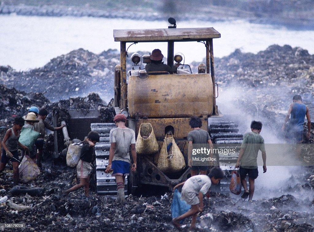 Children in Landfill : Stock Photo