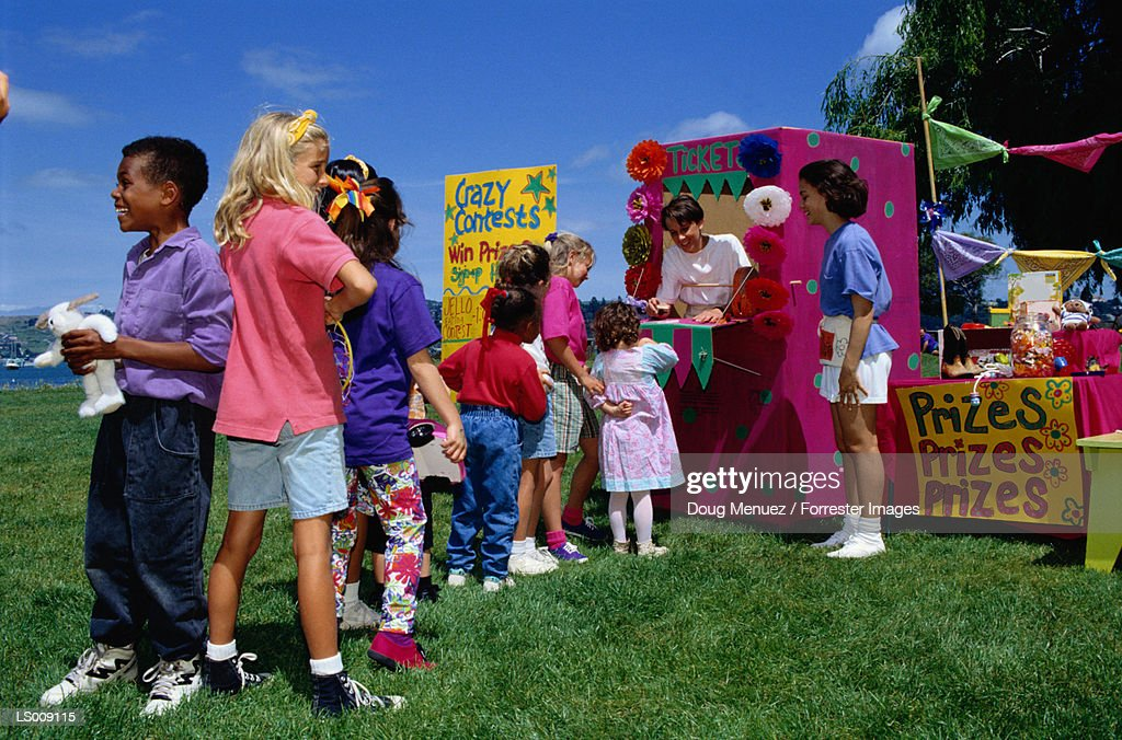 Children in Line at Fair Booth : Stock Photo