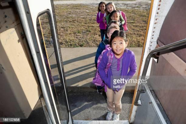 Children in line to board school bus