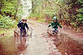 Children in mud puddles