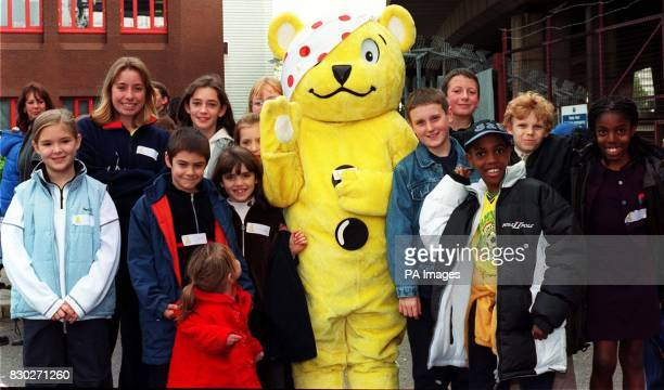 Children In Need mascot Pudsey Bear with some of the children who queued outside BBC Worldwide for the chance to sing with former EastEnders Martine...