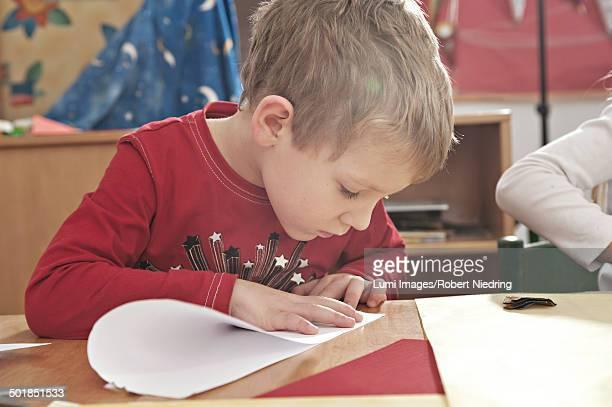 Children In Nursery School Folding Paper Planes, Kottgeisering, Bavaria, Germany, Europe