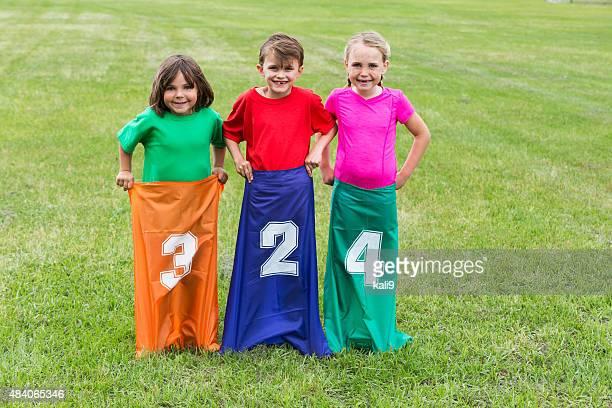 Children in park ready for a potato sack race