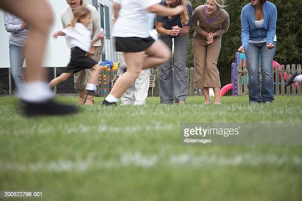 Children (4-8) in school sports day race (blurred motion)
