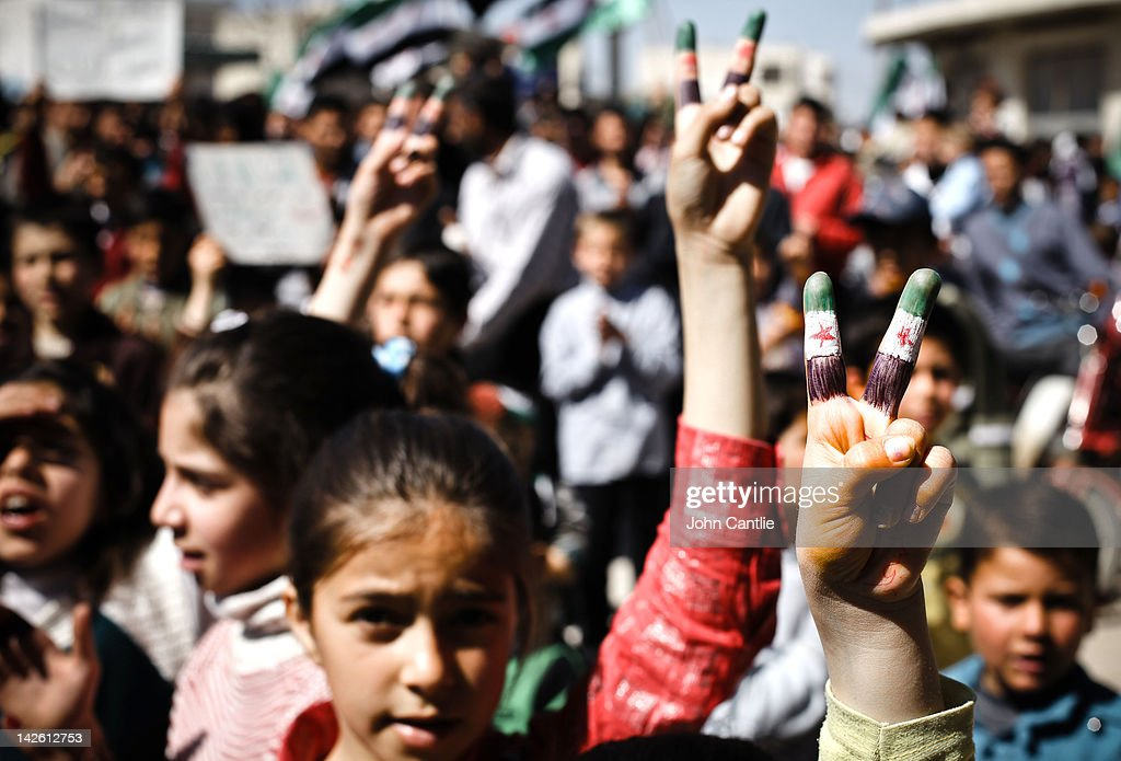 Children in Tamanaa town show their support for the revolution with their fingers painted in the revolutionary colours on April 9, 2012 in Syria. Conitnuing violence in northern Syria between government forces and rebels is putting plans for a UN-brokered Syria ceasefire on Tuesday in jeopardy.