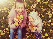 Portrait of beautiful children in the autumn oudoors and foliage