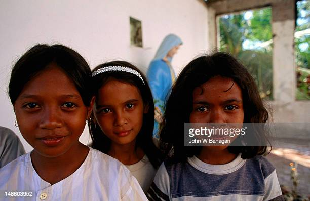 Children in the burnt out church, Dili.