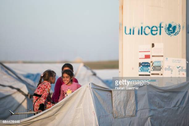 Children in the refugee camp 'Hasansham U3' In the background the Unicef logo is printed on a container on April 20 2017 in Hasansham Iraq