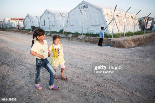 Children in the refugee camp 'Hasansham U3' Tents of Unicef are standing in the background on April 20 2017 in Hasansham Iraq