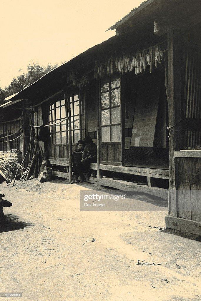Children in wooden house : Stock Photo