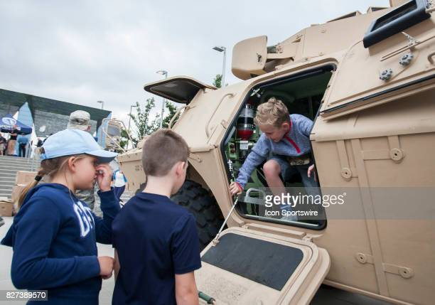 Children interact with military equipment during Military Appreciation day at Children's Mercy Park before the match between Sporting Kansas City and...