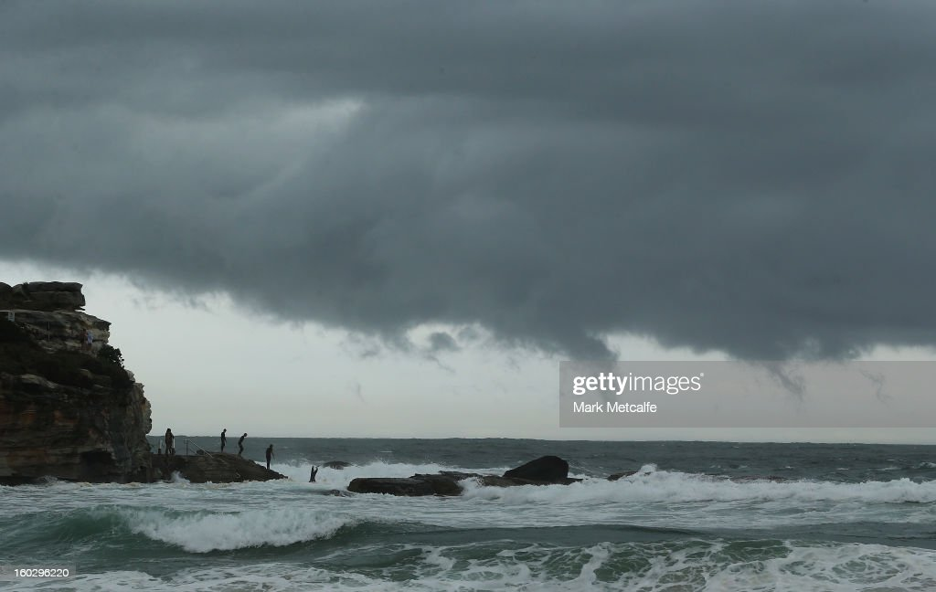 Children jump into a rock pool at Coogee Beach after winds and rain battered Sydney last night on January 29, 2013 in Sydney, Australia. Parts of Sydney are experienced record rainfall after ex-cyclone Oswald swept through the city last night.