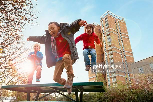 Children jumping for joy in park