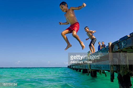 Children Jumping Off Pier in Puerto Morales Mexico