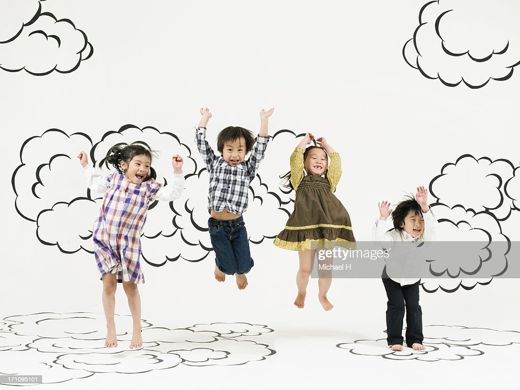 children jumping  on the clouds : Stock Photo