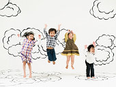 children jumping  on the clouds