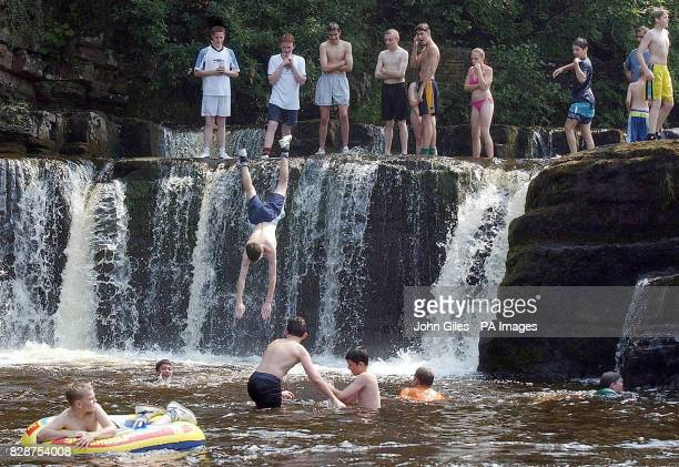 Children keep cool as the temperature climbs in the River Swale in Richmond North Yorkshire Britain's heatwave could peak with record temperatures...