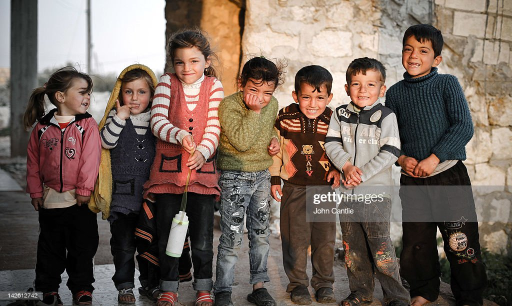 Children laugh in a border village near the Turkish border on April 9, 2012 in Syria. Conitnuing violence in northern Syria between government forces and rebels is putting plans for a UN-brokered Syria ceasefire on Tuesday in jeopardy.