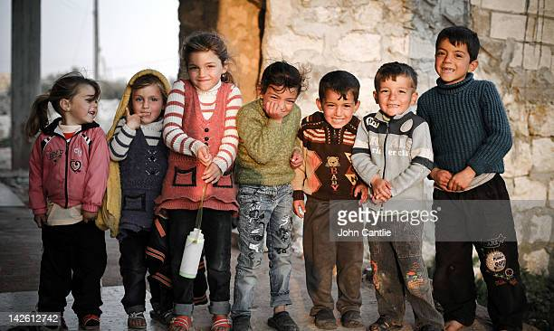 Children laugh in a border village near the Turkish border on April 9 2012 in Syria Conitnuing violence in northern Syria between government forces...