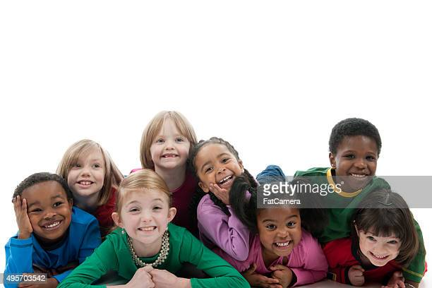 Children Laughing in a Dog Pile