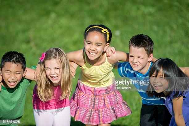 Children Laughing Together at the Park