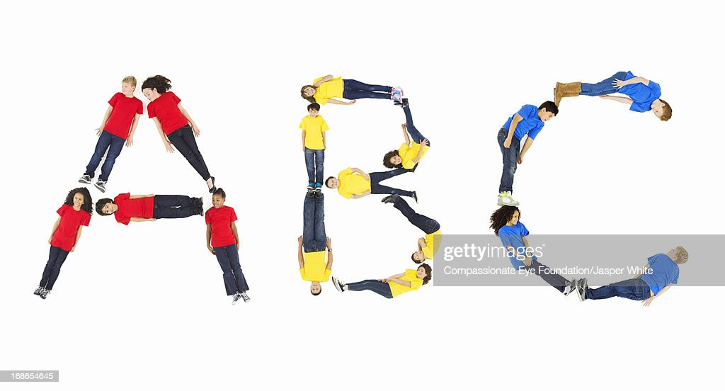 Children laying in 'ABC' formation : Stock Photo