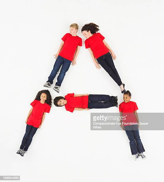 Children laying in letter 'A' formation