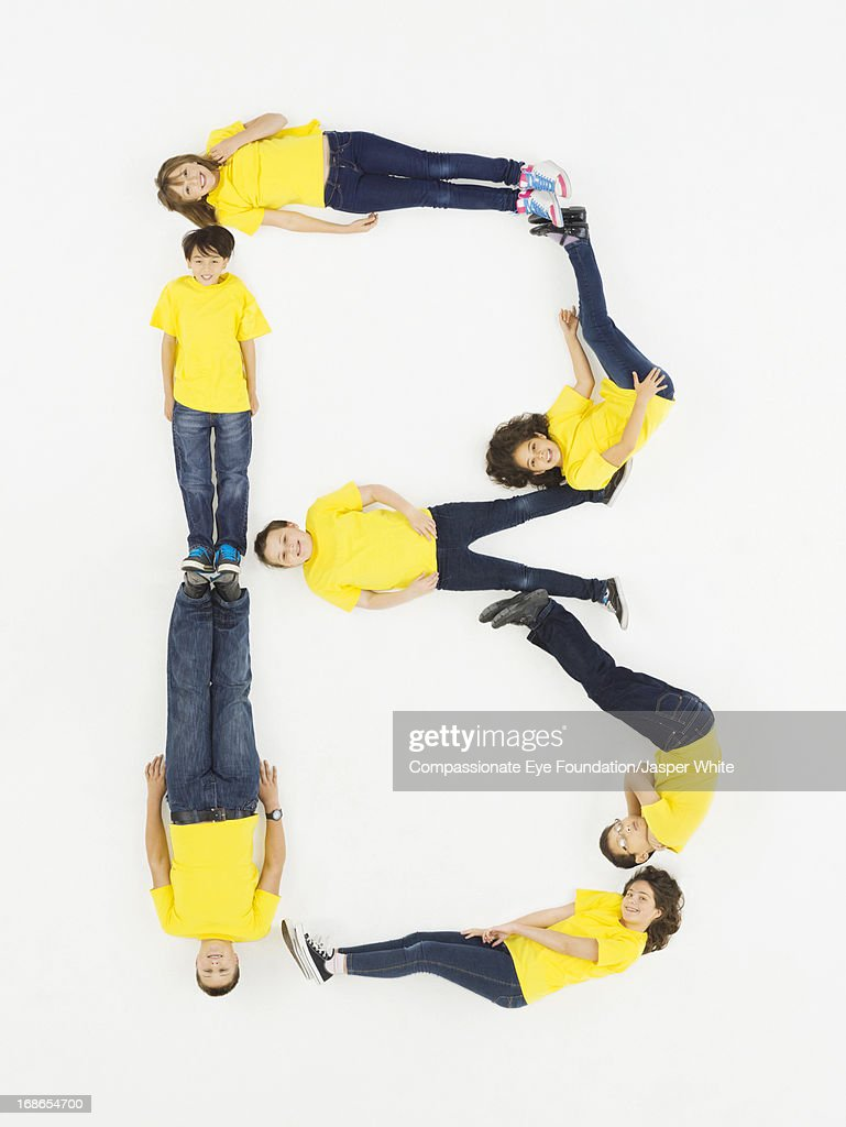 Children laying in letter 'B' formation : Stock Photo