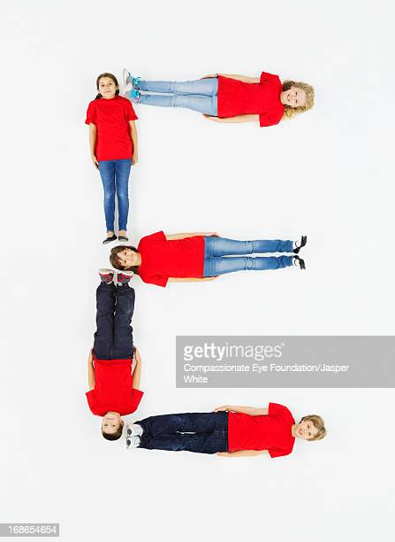 Children laying in letter 'E' formation