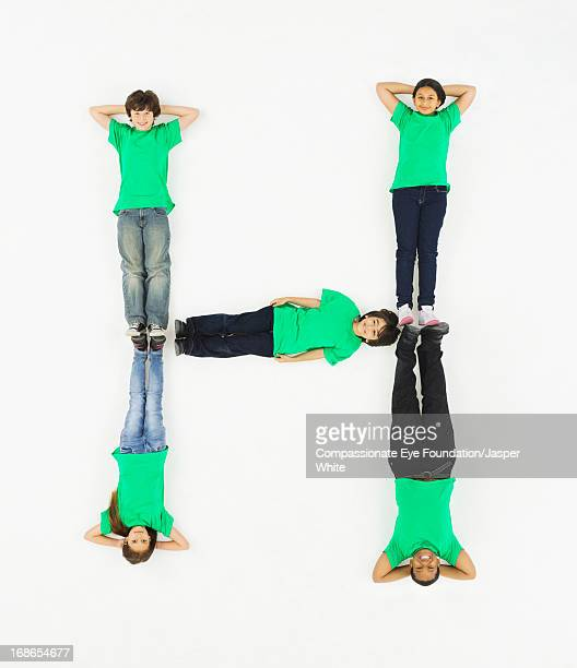 Children laying in letter 'H' formation
