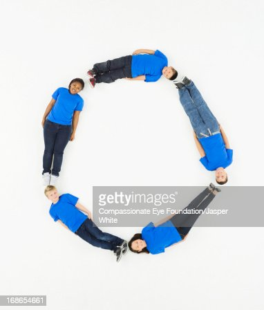 Children laying in letter 'O' formation : Stock Photo
