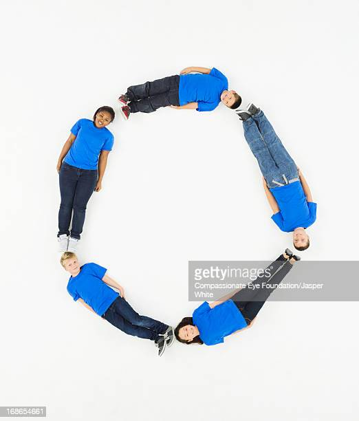 Children laying in letter 'O' formation