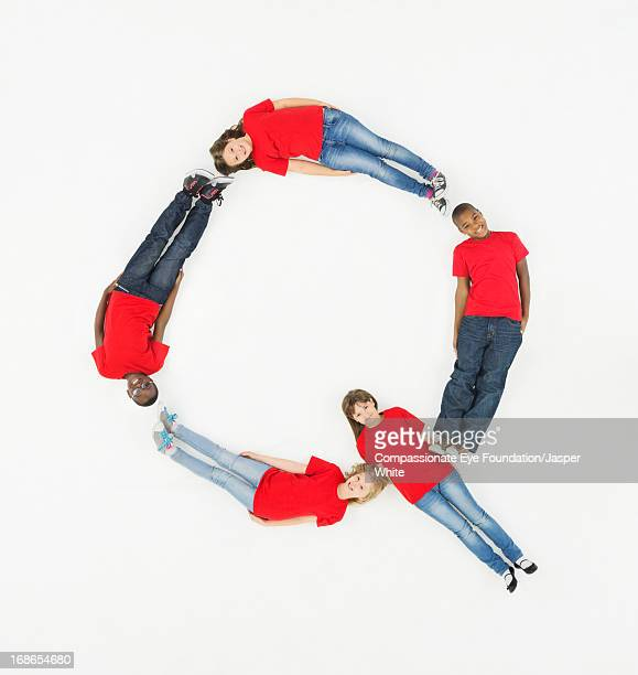 Children laying in letter 'Q' formation