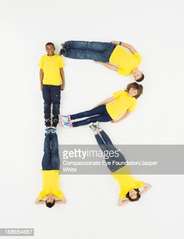 Children laying in letter 'R' formation : Stock Photo