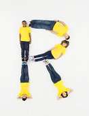 Children laying in letter 'R' formation
