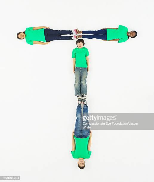 Children laying in letter 'T' formation