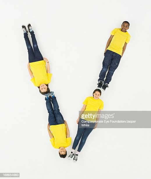 Children laying in letter 'V' formation