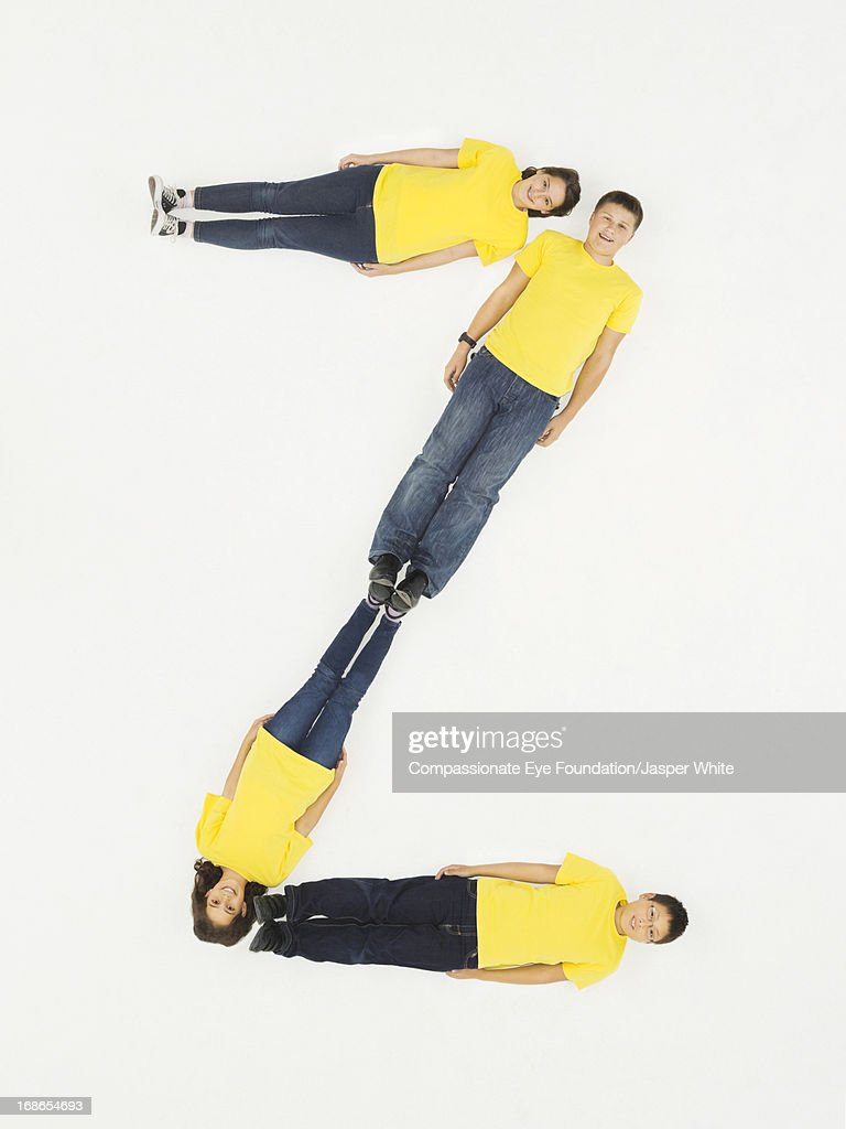 Children laying in letter 'Z' formation
