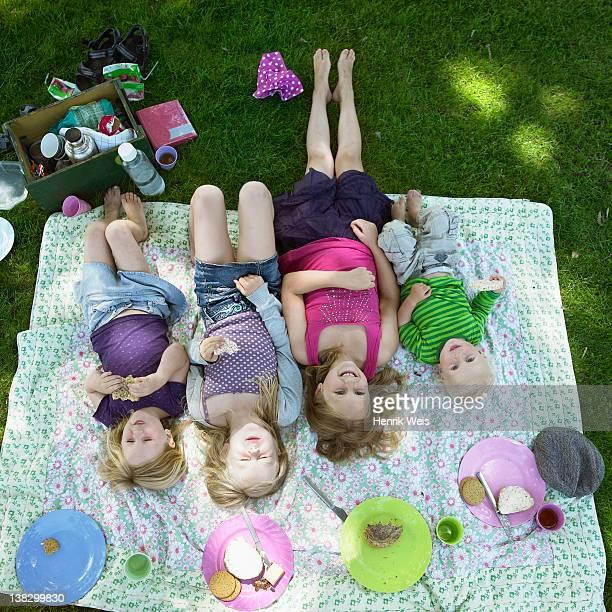 Children laying on picnic blanket