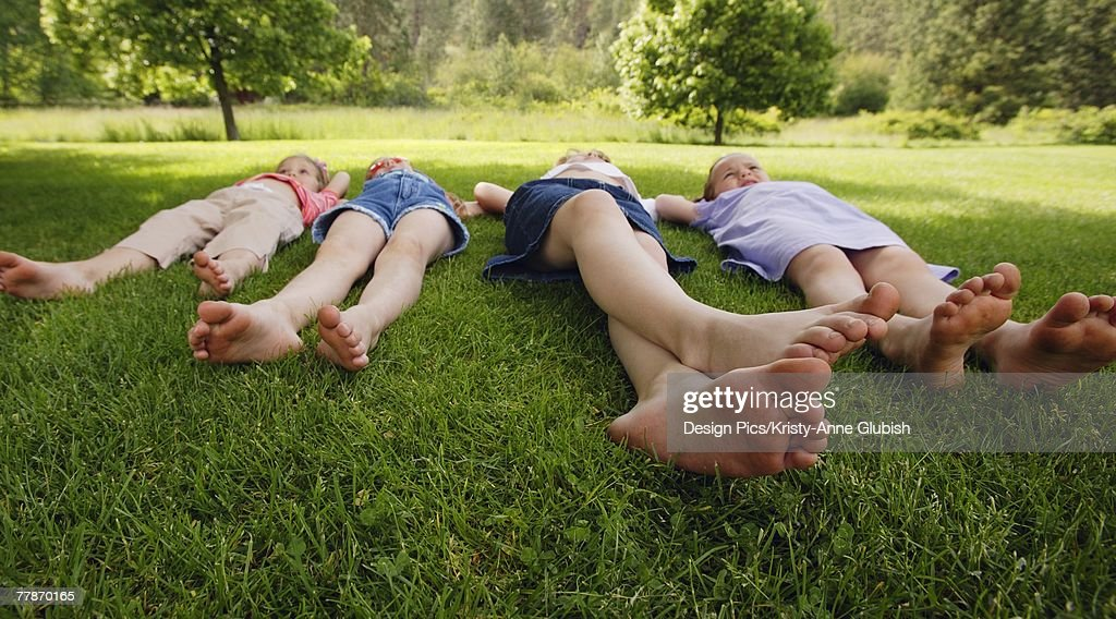 Children laying on the grass