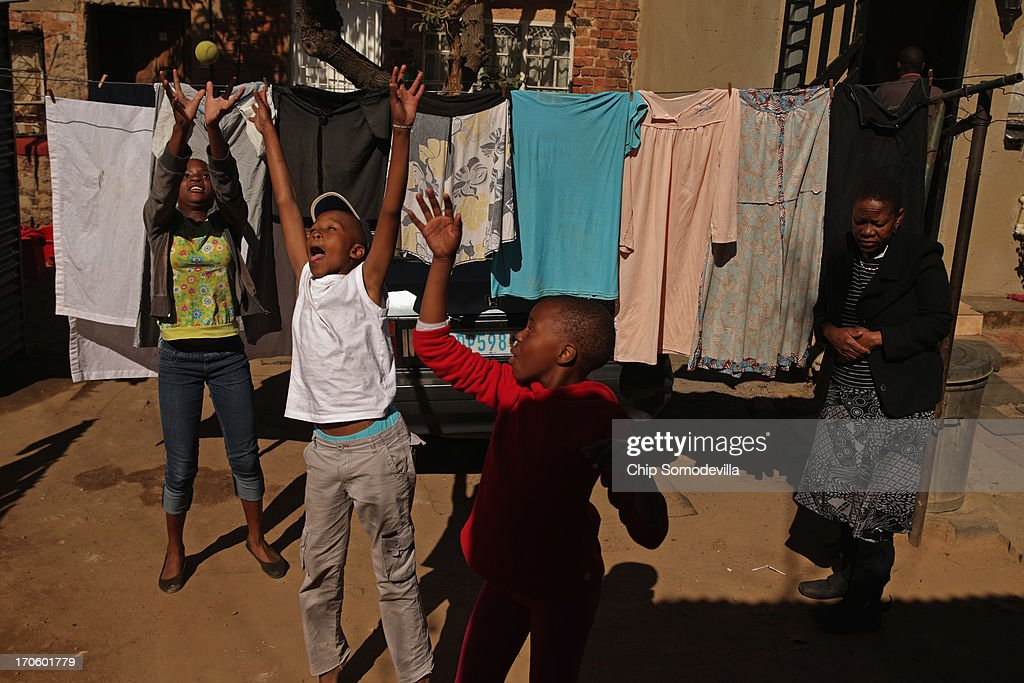 Children leap as they play ball in an alley behind shacks in the Alexandra Township around the corner from where former South African President Nelson Mandela lived in the 1940s June 15, 2013 in Johannesburg, South Africa. A leader of the anti-apartheid movement and the first democratically elected president of South Africa, Mandela is spending a seventh night in hospital and is reported to be responding better to treatment for a recurring lung infection.