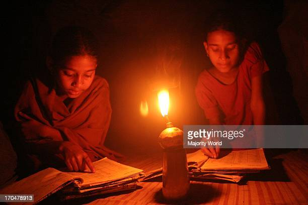 Children learning their lessons at home in a village in Netrokona Bangladesh February 15 2009