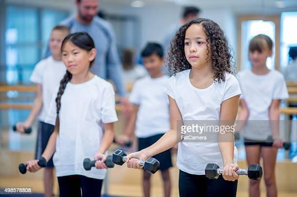 Children Lifting Weights