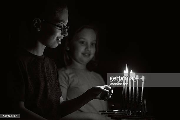 Children (8-9) lighting Menorah