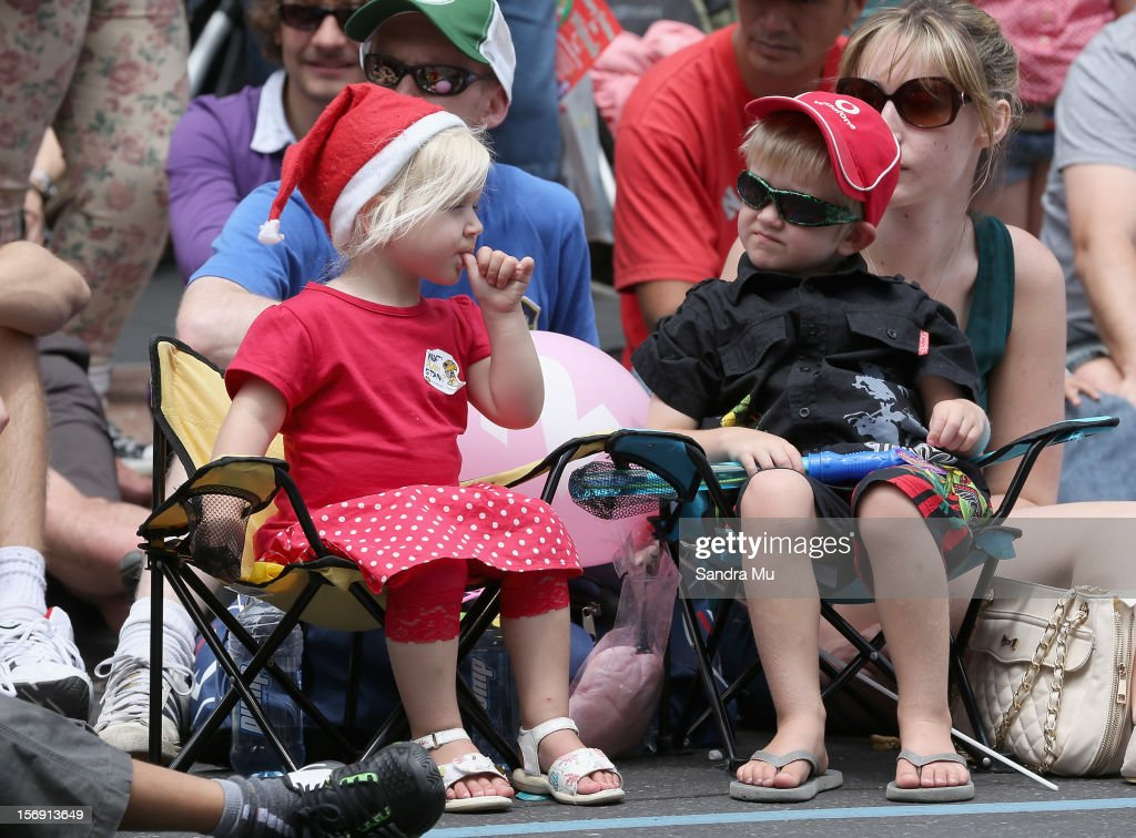 Children line the street to watch the annual Farmers Santa Parade on November 25, 2012 in Auckland, New Zealand. For 78 years the Farmers Santa Parade has brought joy to the children of Auckland marking the start of the Christmas season.