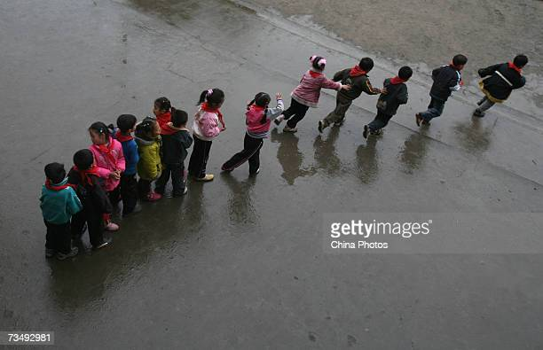 Children line up to walk to the dining hall during lunch time at the Jielong Primary School on March 5 2007 in Chongqing Municipality China Chinese...
